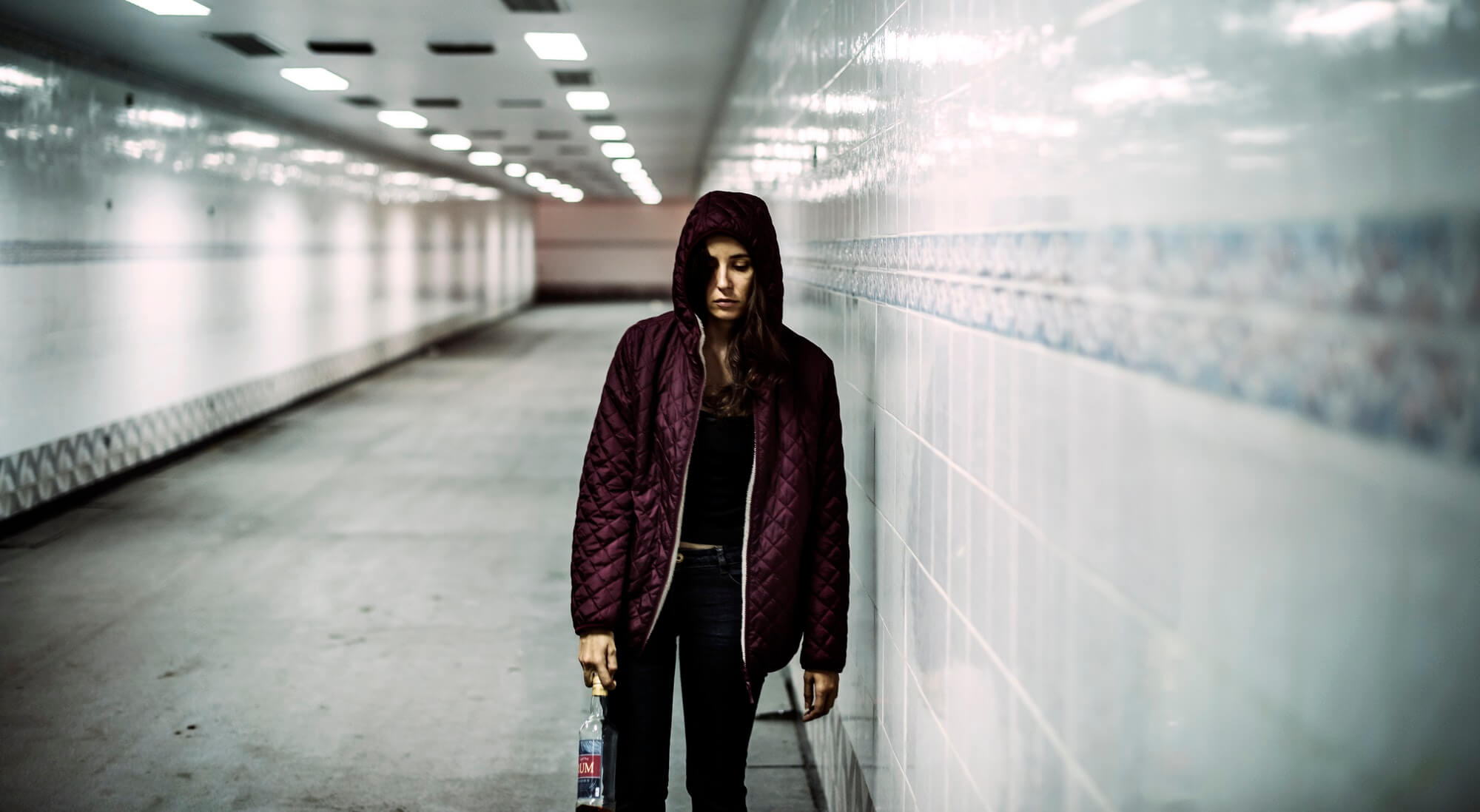 Homeless Alcoholism Woman Holding Liquor Bottle
